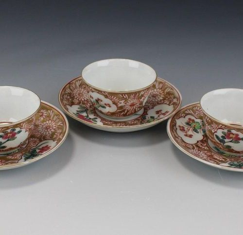 Three small size famille rose cups and saucers Three small size famille rose cup…