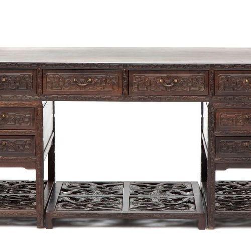 A Chinese hongmu pedestal desk A Chinese hongmu pedestal desk, Late 19th/early 2…
