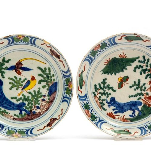 A pair of Delft polychrome pottery plates A pair of Delft polychrome pottery pla…