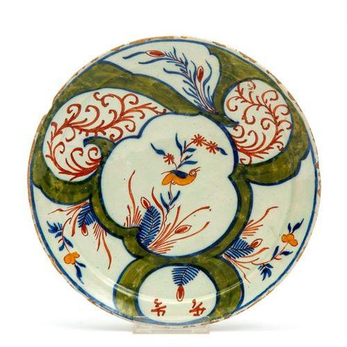 A Delft polychrome pottery plate A Delft polychrome pottery plate, 18th century,…
