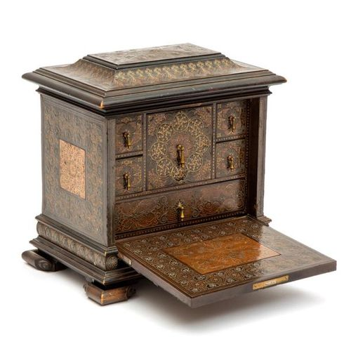An ebonised brass, pewter, and copper lined miniature table cabinet An ebonised …