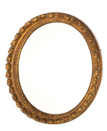 A Napoleon III giltwood and stucco oval mirror A Napoleon III giltwood and stucc…