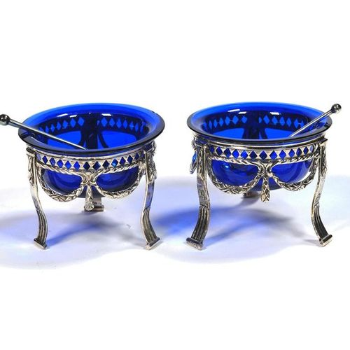 A pair of Dutch silver salt cellars with blue glass liners A pair of Dutch silve…