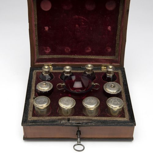 A German wooden travel case with silver gilt and ruby glass items, Augsburg Un c…