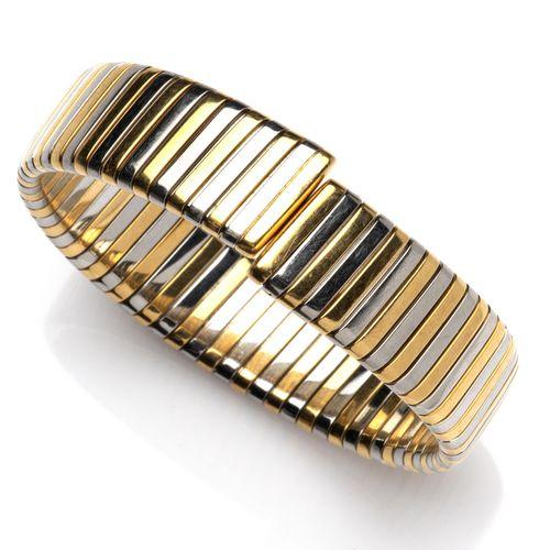 A steel and 18k gold bangle, by Bulgari Bangle en acier et or 18k, par Bulgari, …