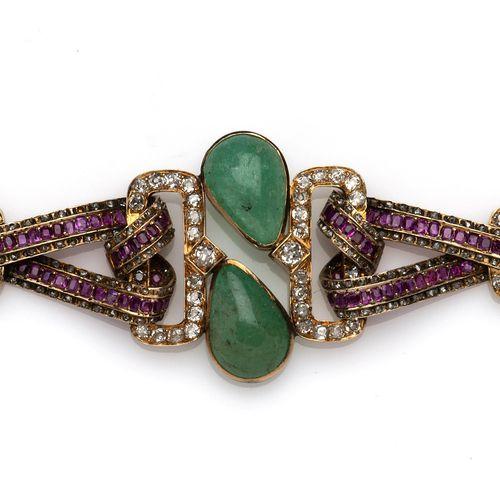 A 14k gold emerald and ruby bracelet Bracelet en or 14k à émeraudes et rubis, Le…