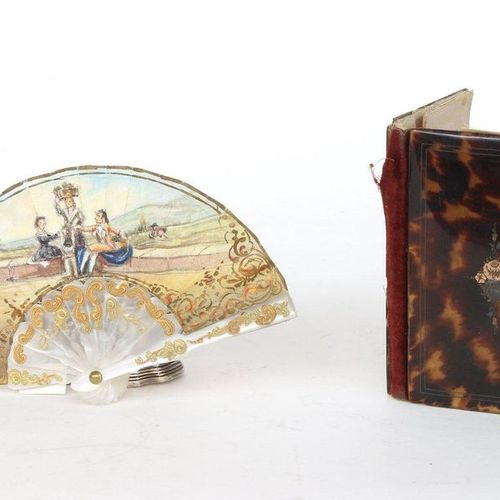 Painted doll fan and dance card. Two cigarette holders in burgau are attached.