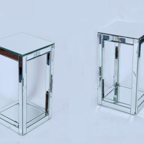 Pair of mirror plated saddles, bevelled edges.Dim: 65X36X36