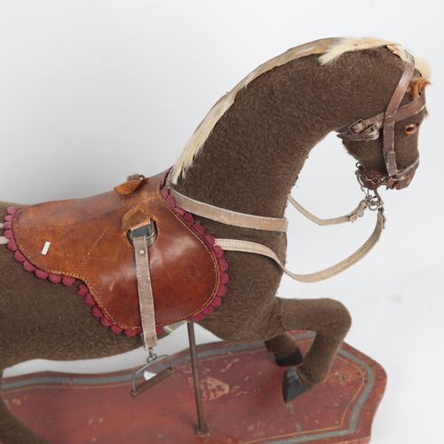 Child's horse, roulette wheel, felt, leather saddle.