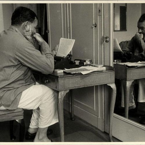 "Hutton, K. (1893 1960). ""Hemingway at work"". Gelatin silver print, 15x20,5 cm., …"