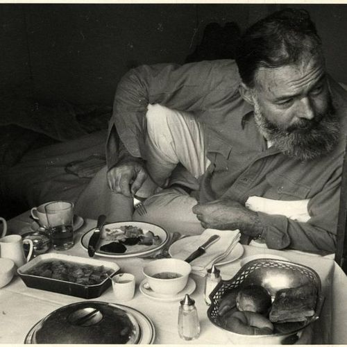 "Hutton, K. (1893 1960). ""The writer [Ernest Hemingway] takes his breakfast in be…"