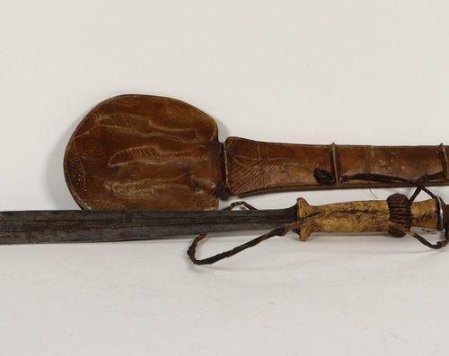 [Tribal art. Africa]. Knife with sheath, Yaka, Angola. Iron, wood, copper and an…