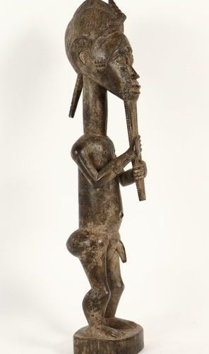 [Tribal art. Africa]. Standing male figure, Baule, Ivory Coast. Carved wooden st…