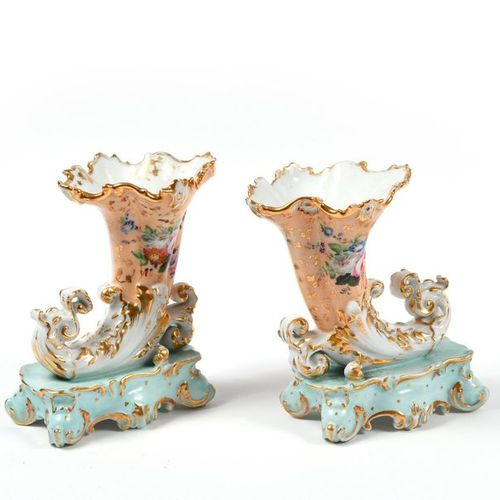 Two pairs of vases in porcelain, one imitating a horn of plenty with a floral de…