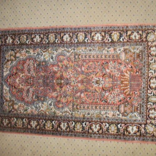Silk prayer rug, Hereke, red background, decorated with a tree of life and a mos…