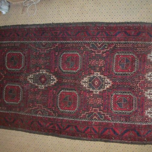 Belushistan carpet, brown or olive green background, decorated with medallions a…