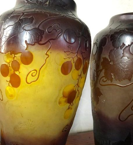 Establishment GALLE  Pair of ovoid shaped vases in purple lined glass on a yello…