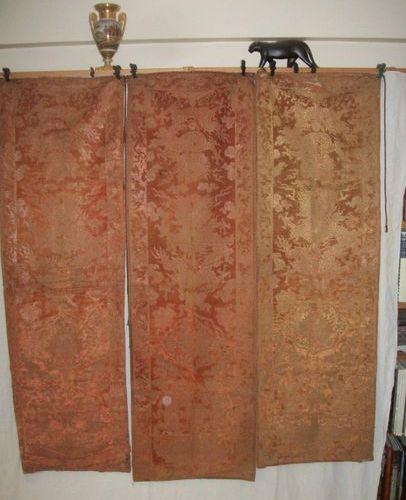 Suite of three tangerine velvet hangings, China, Qing dynasty, XIXth century, de…