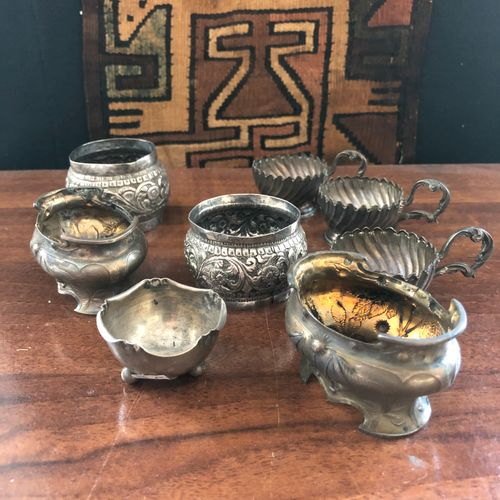 Lot of 8 silver plated pieces including egg cups, napkin rings,...