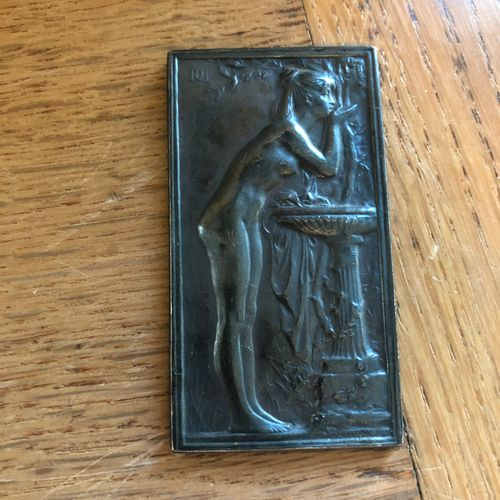 Woman at the fountain  Plate in repoussé resting on an easel