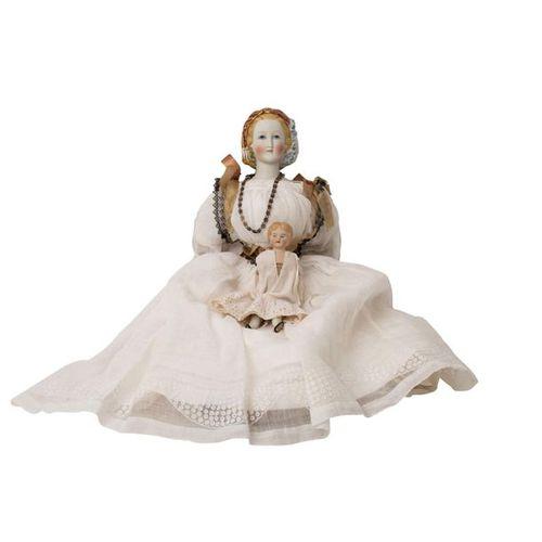 Zwei Biskuitporzellankopfpuppen, 19. Jh. Two bisque head dolls, 19th century, bi…