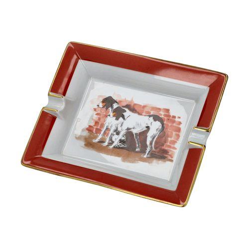 HERMÈS Dekoschale/Aschenbecher. HERMÈS装饰碗。零售价为560欧元。中央有两只狗在砖墙前,白地有锈红色的边框和金色的边框。状…