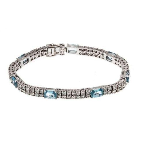Aquamarine and brilliant bracelet WG 585/000 with 7 oval faced aquamarines, tota…