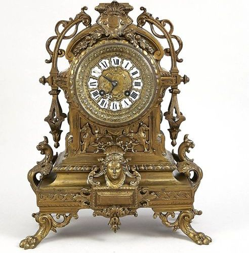 Table clock bronze France 2.H. 19th c., standing on paw feet, historicizing, ope…
