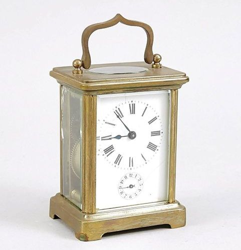 Travel clock 1st half 20th century, brass gilded, with top mounted handle, white…