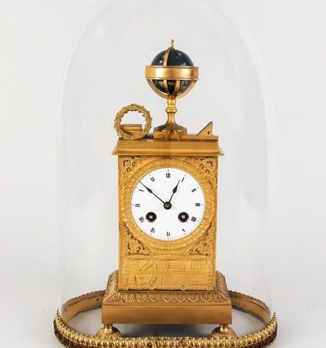 Empire pendulum, bronze, gilt as well as partly blue lacquered, high rectangular…