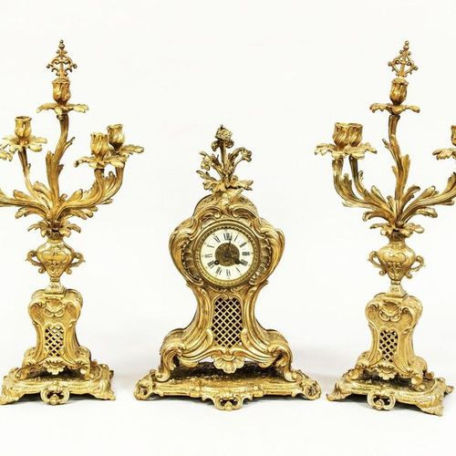 Fireplace clock set, 3 piece, France, 2nd half 19th c., gilded, in historicism s…