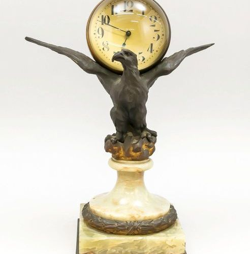 Table clock bird of prey carrying a magnifying ball with clock inside, bronzed w…