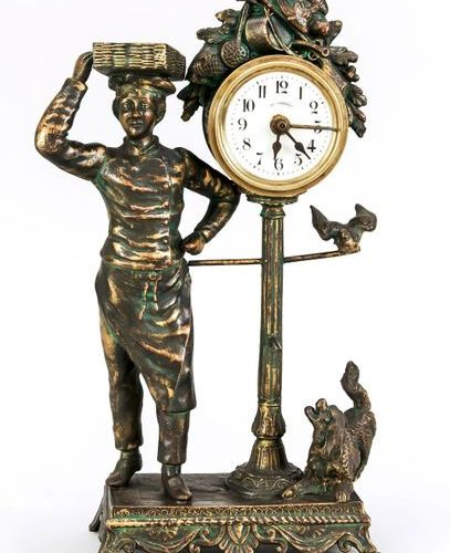 Small table clock bronzed gunmetal, boy with basket on pedestal, next to it cloc…