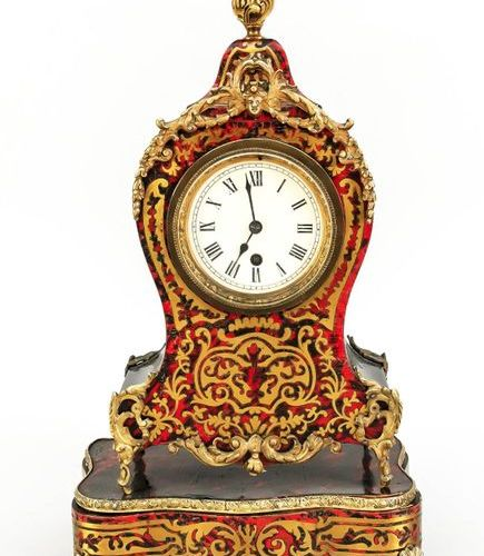Small table clock in boulle style with reddish ground on corresponding base, 2nd…