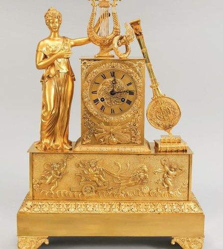 Empire pendulum, 1st half of the 19th century, fire gilded, standing lady at a l…