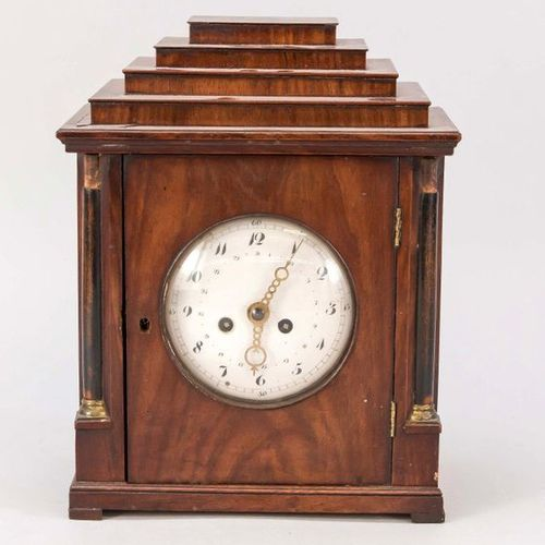 Wooden table clock, 1st half 19th c., with ebonized columns upper finish missing…