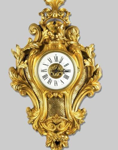Large cartel clock, brass, fire gilded, 2nd half 19th c., decorated with rocaill…