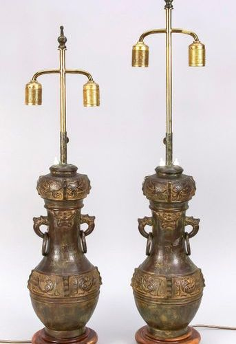 Pair of lamps with vase bases, China, 20th c. Archaizing bronze vases with free …
