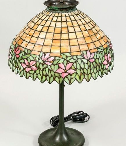 Tiffany style lamp, mid 20th c. Round base and slender shaft in bronze look, sha…
