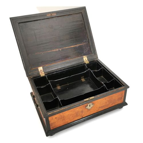 Ebony and various wood species case with sober decoration of mouldings in doucin…
