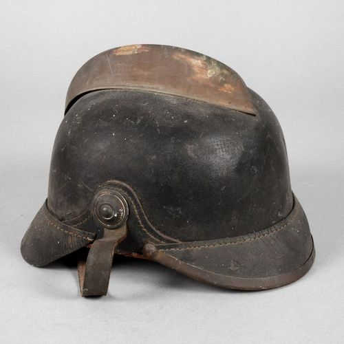 Fire helmet  around 1900, leather dome with metal comb, visible signs of age, di…