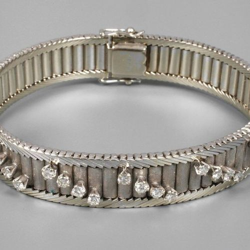 Bracelet with diamonds  circa 1970, white gold stamped 750, ca. 12 mm wide, elab…