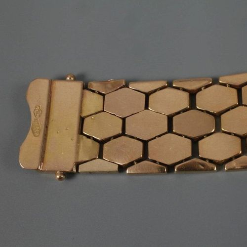 Gold bracelet  c. 1970, yellow gold tested 750/1000, ca. 19 mm wide strap, some …