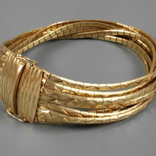 Multi row gold bracelet  c. 1980, yellow gold stamped 750, box lock with two saf…