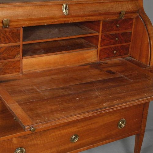 Cylinder office  ca. 1800, solid walnut, two part corpus on pointed square feet,…