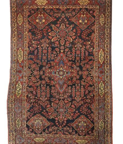 Tapis à médaillons avec cartouches d'inscription Perse, vers 1930, laine sur cot…
