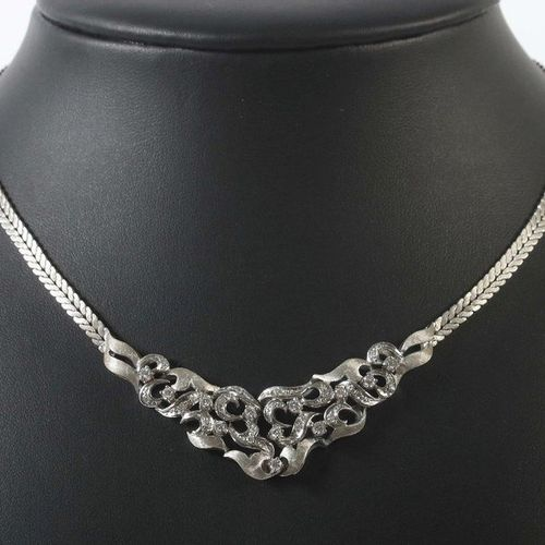 Necklace from the 1980s, white gold 585, centre piece of stylized tendrils, open…