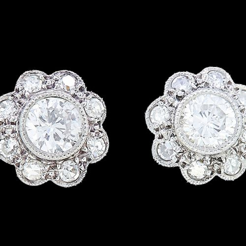 PAIR OF DIAMOND CLUSTER EARRINGS, set with a central diamond by a row of diamond…
