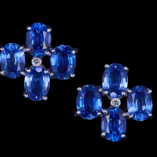PAIR OF SAPPHIRE AND DIAMOND EARRINGS, set with a central diamond, surrounded by…