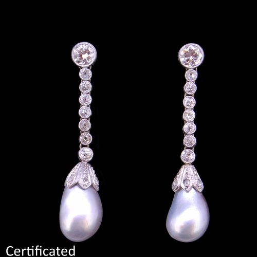 IMPORTANT PAIF OF NATURAL SALTWATER PEARL AND DIAMOND DROP EARRINGS, set with a …